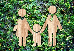Family wood icon on green leaf wall,Eco concept.